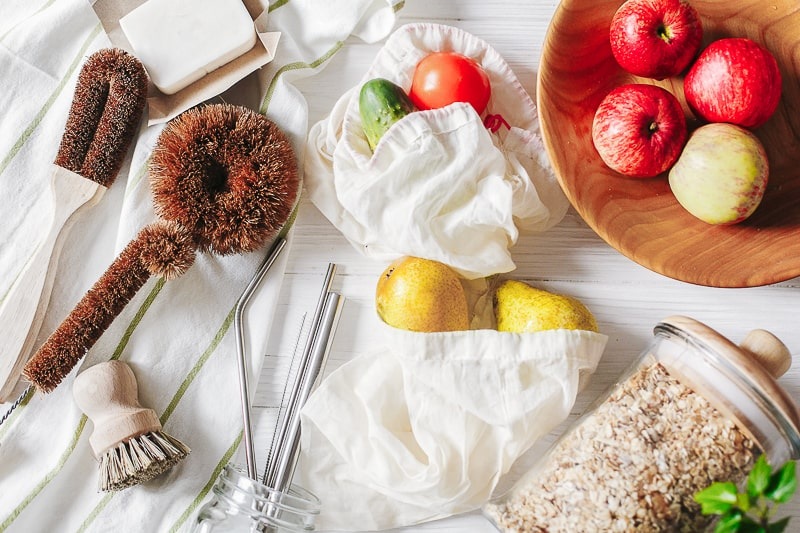 Fresh produce in beige bags and zero waste cleaning supplies