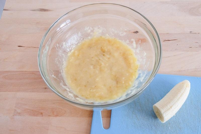 mashed bananas in bowl on table vegan buckwheat banana pancakes