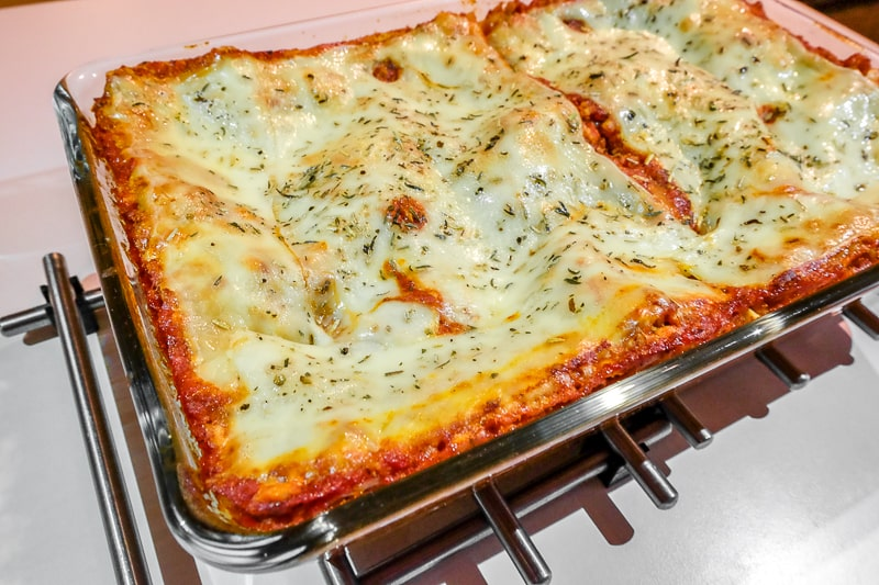 vegetarian lasagna with cheese in baking pan on table