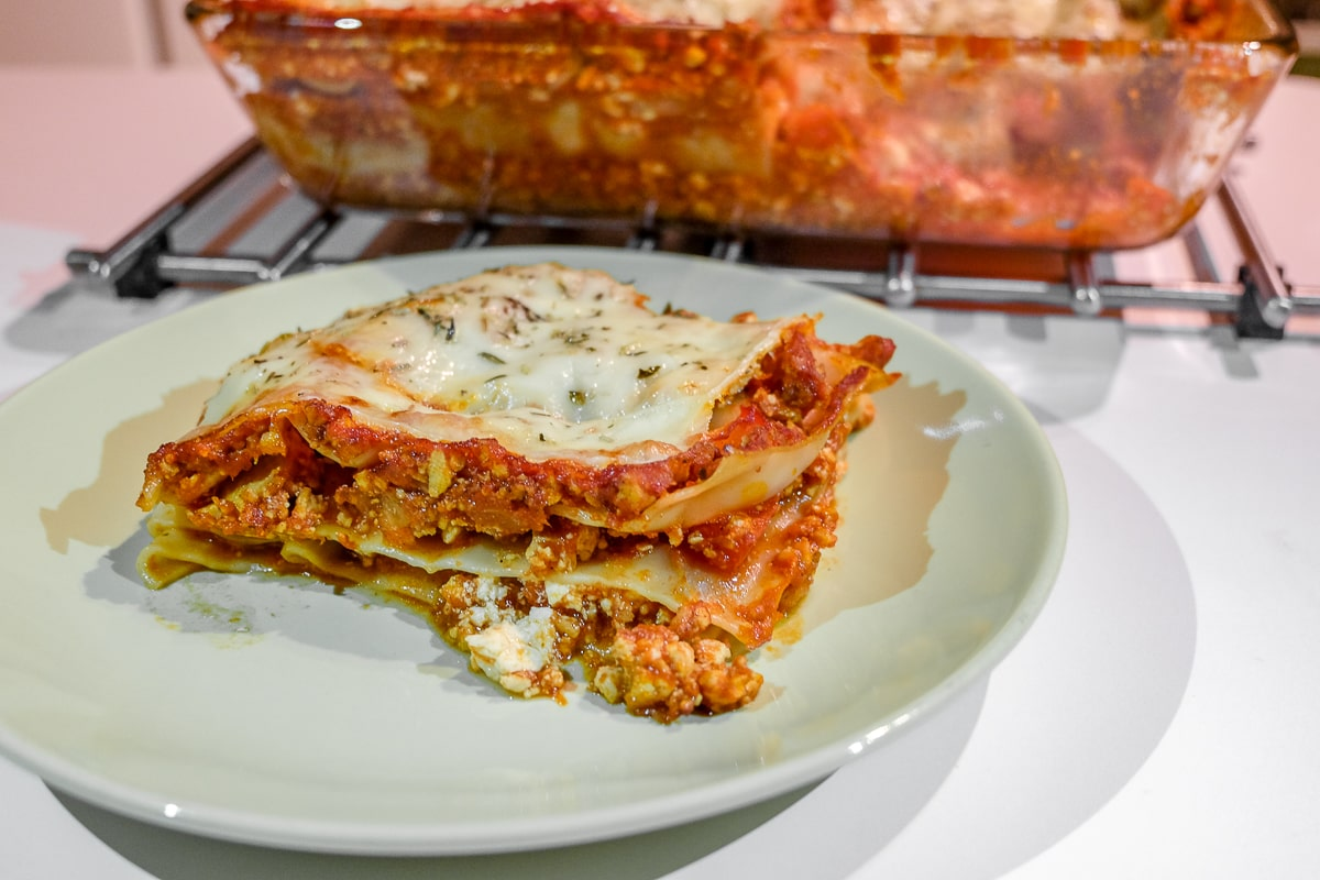 slice of easy vegetarian lasagna on plate on table
